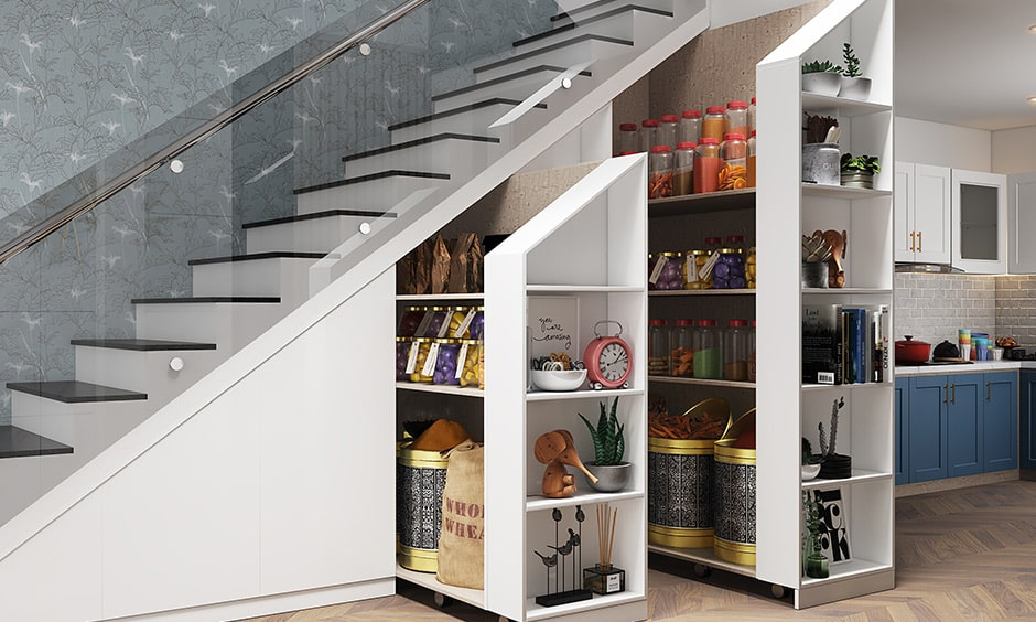 Kitchen pantry design with a dead space under the staircase transformed into a clever pull out kitchen pantry design