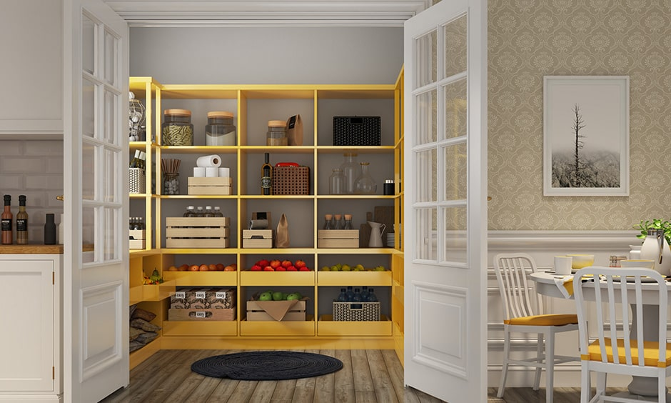 Kitchen pantry design with yellow painted kitchen pantry to store groceries and greens