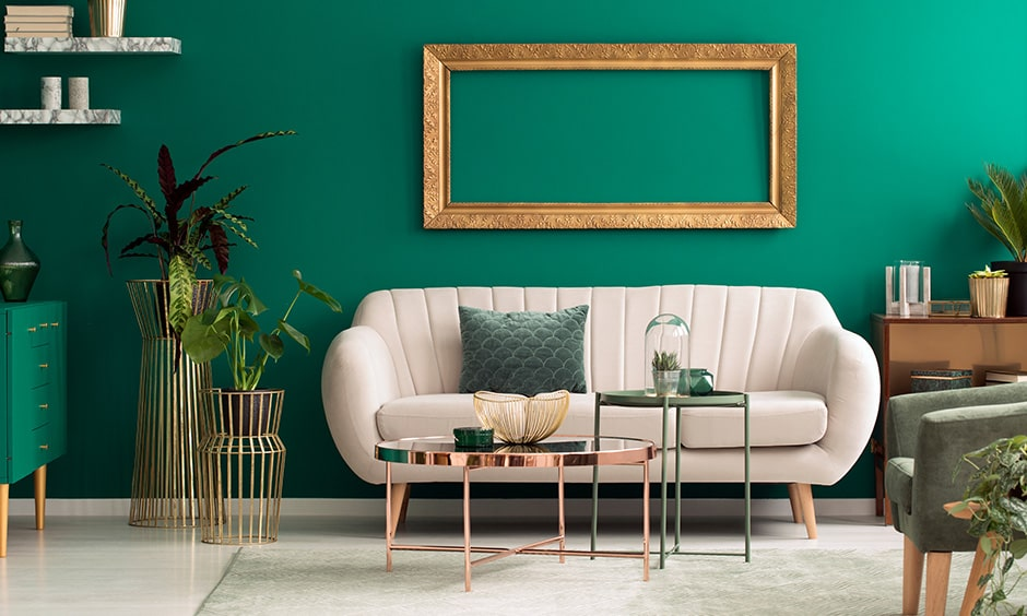 Green colour combination for living room with emerald statement wall, green sideboard and plants