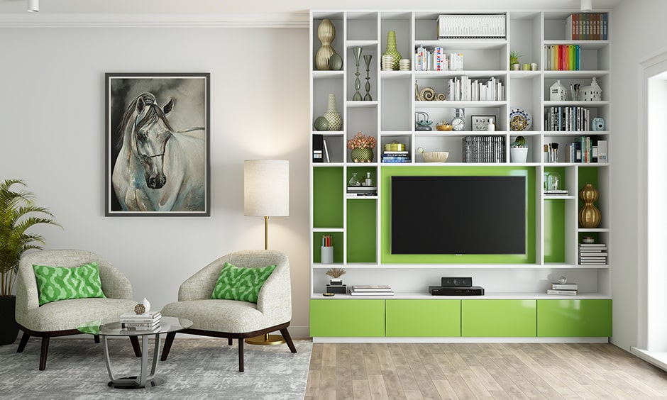Living room design with olive green on tv unit and upholstery