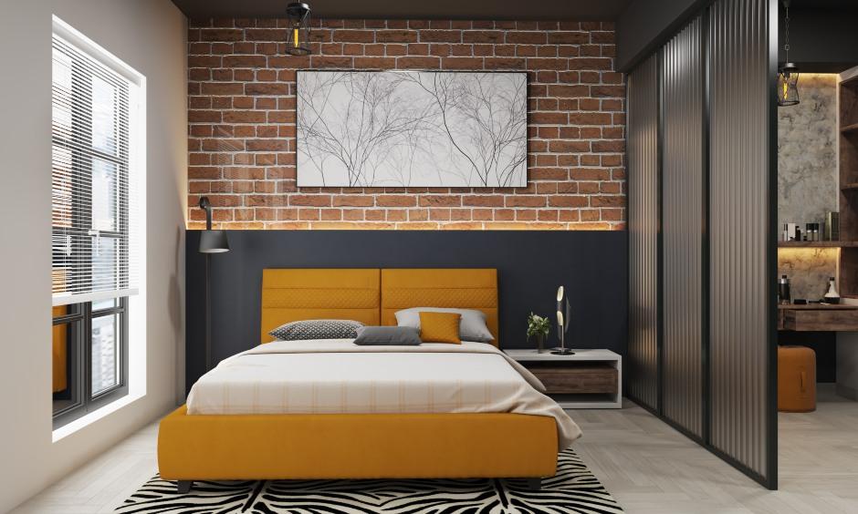 Bedroom design in industrial style bedroom with a black, sleek sliding door wardrobe
