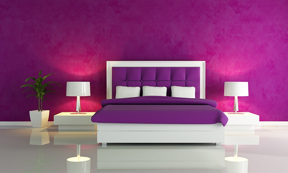 Purple bedroom with a textured purple wall and tinge of pink