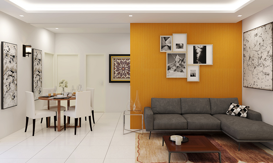 Yellow living room wall resembles the colour of autumn leaves and feels retro fusion with a black and white frame.