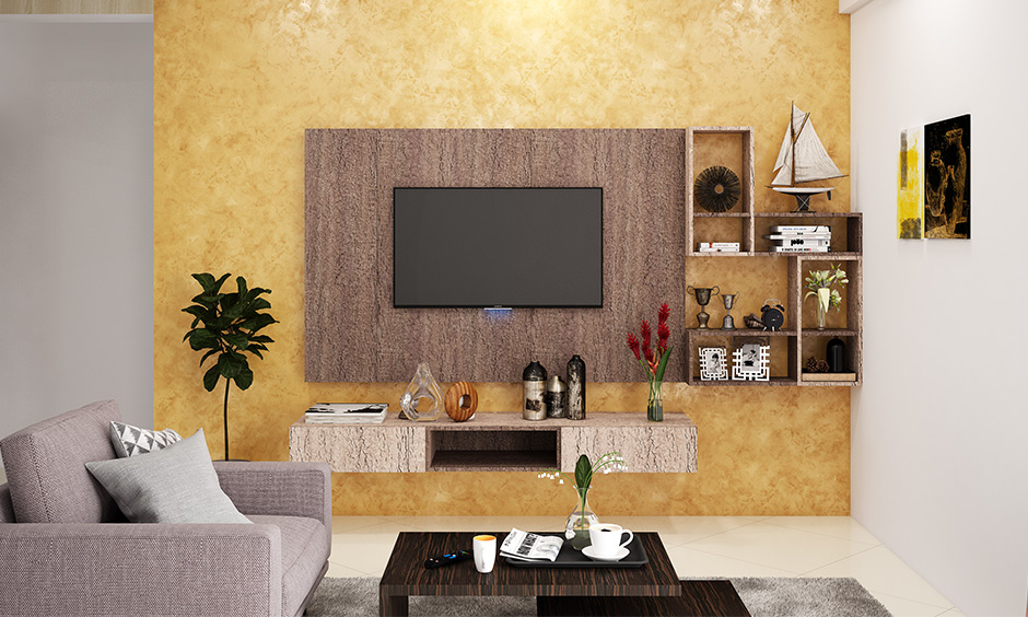 Golden-yellow walls living room with wall-mounted wooden backsplash brings out a choco-banana combination.