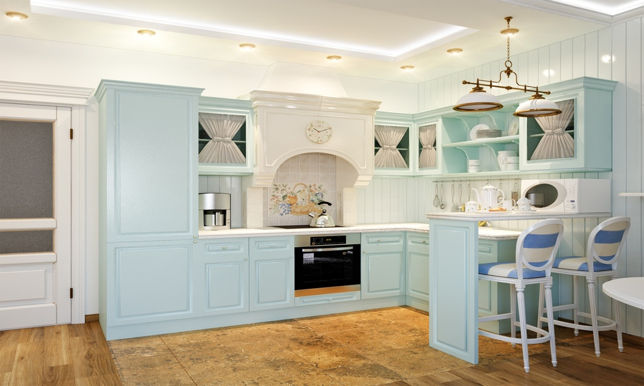 This pastel blue country kitchen design provides you with a breakfast counter attached to the island and looks rustic.