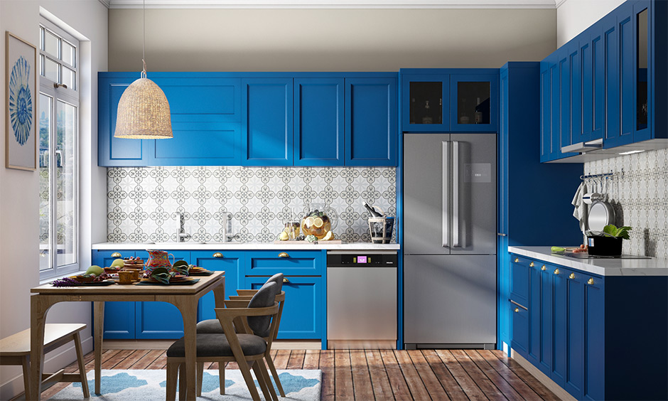 This bold kitchen design has a tall unit with sliding wooden doors and built-in wooden drawers which provide deep storage.
