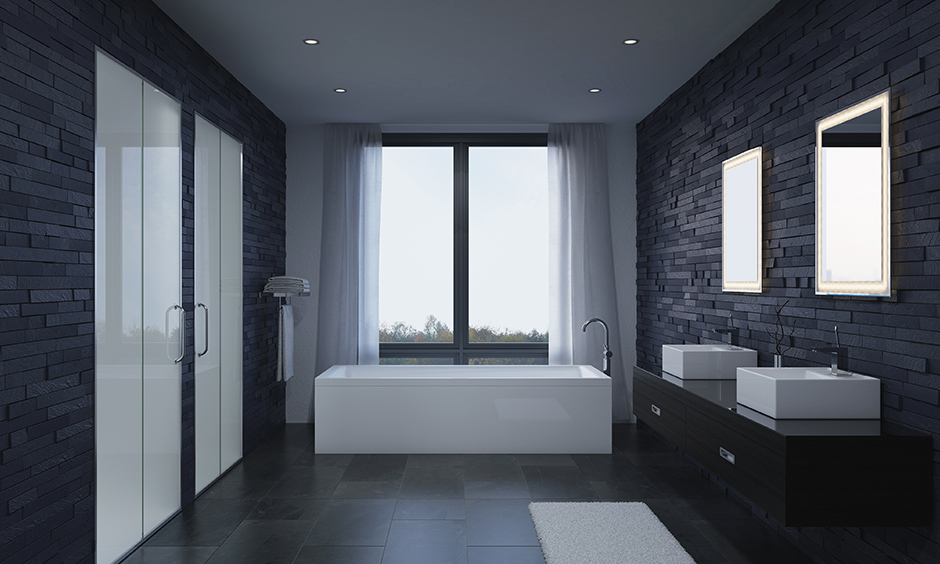 bathroom with bathtub with a minimalistic approach in a black and white themed bathroom