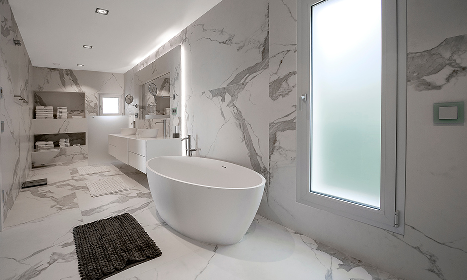 Round bathtub marble stone beauty with a snow-white freestanding bathtub and washbasins in bathroom