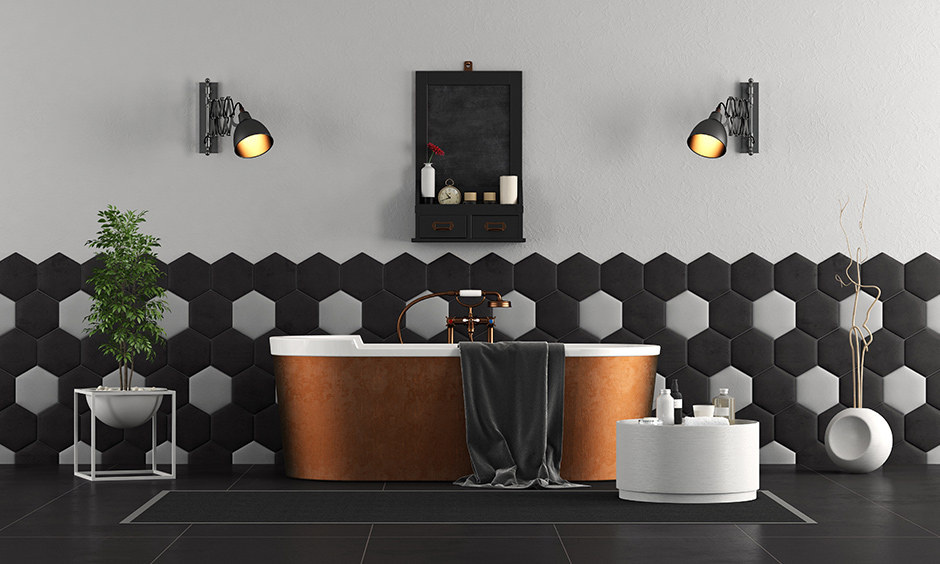 bathtub ideas with a copper tub paired with black tiled floors, geometric patterned walls in black and white
