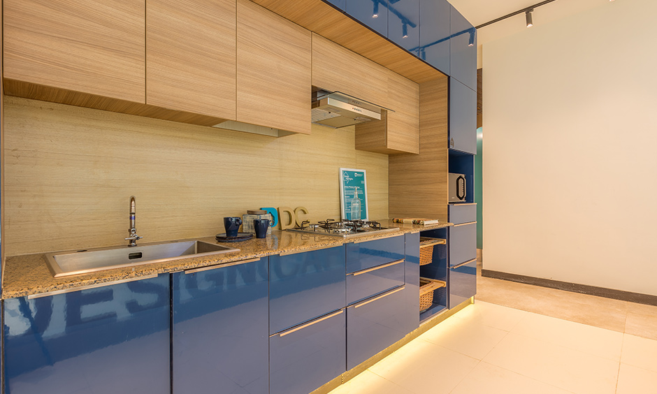 Electric blue urban kitchen with multiple storage options, wicker baskets made their place in the kitchen now.