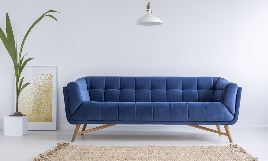 Mid-century modern style sofa design with a rectangular shape, a tufted back seat and wooden legs