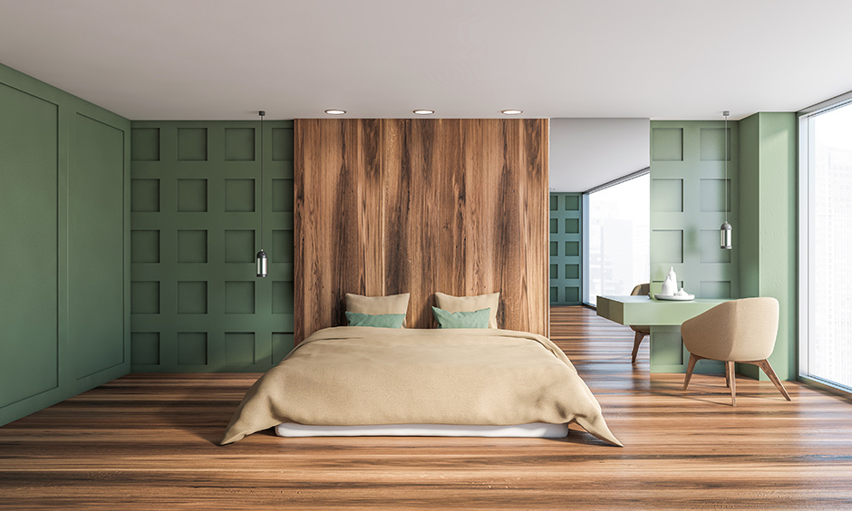Beige chairs and bed blends well with green colour bedroom and looks classic.