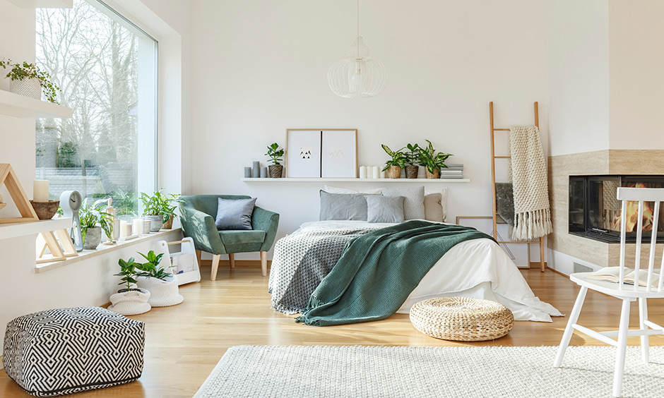 Green bedroom with plants to give life and add visual interest and also help purify the air regularly.
