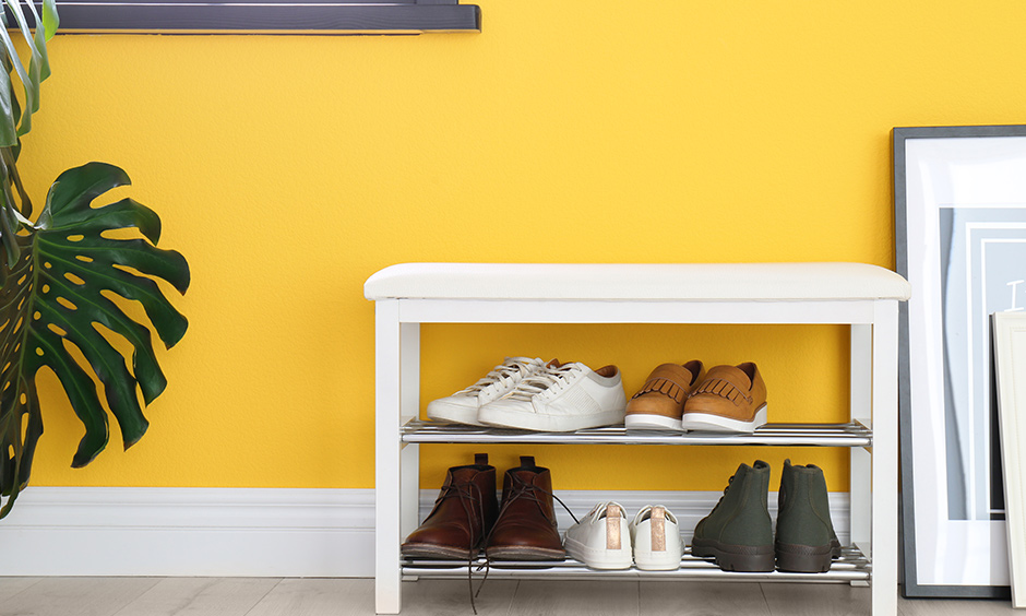 White modern shoe rack design with seat is a comfortable seating option to tie your shoelaces and head out quickly.