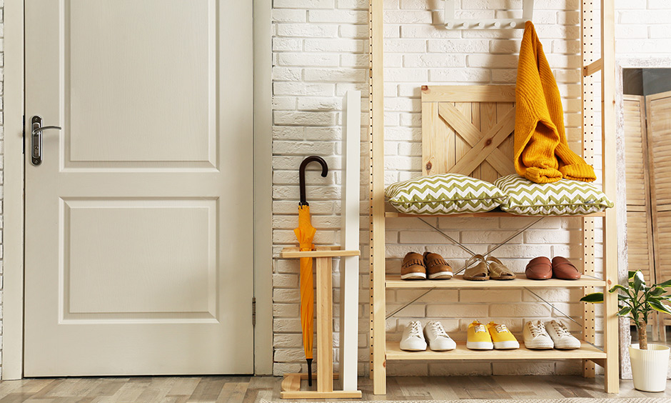 Wooden shoe rack designs with white or neutral coloured walls as the rack is made from wood called simple wooden shoe rack design