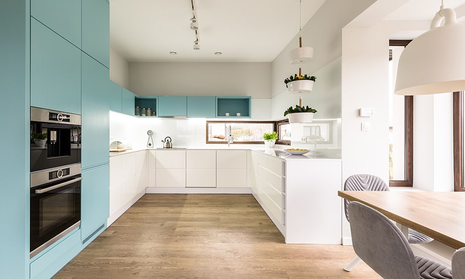 Light blue cabinets is a contrast to all white kitchen design