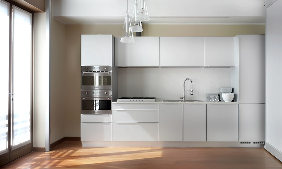 Modern high gloss white kitchen cabinets brings shiny, sleek and stunning to look
