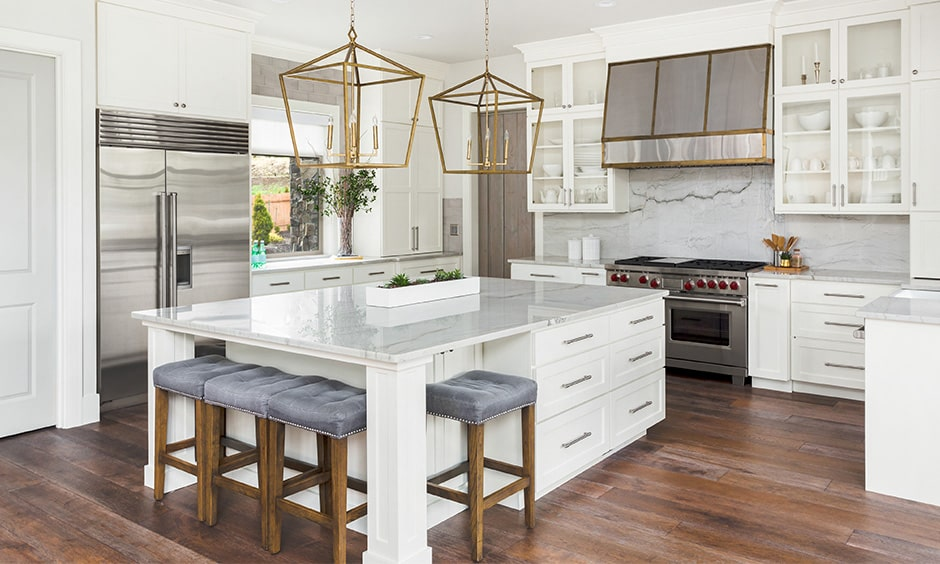 White kitchen cabinets for island kitchen design with a marble countertop