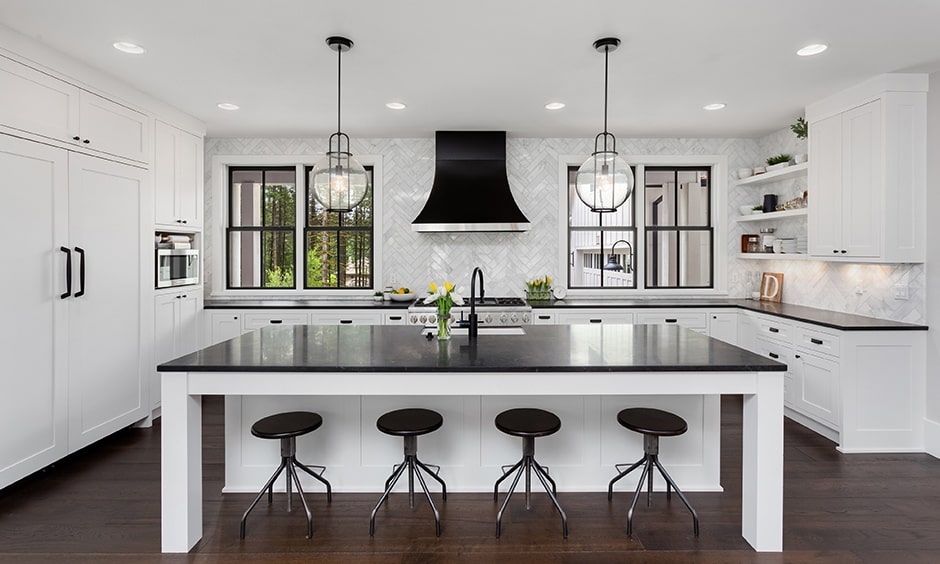White kitchen cabinets images with a black countertop, black chairs and black chimney