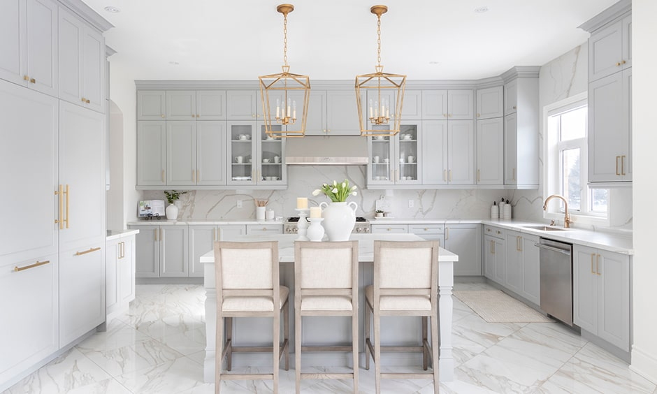 White kitchen cabinets with granite flooring is perfect fit for white cabinets