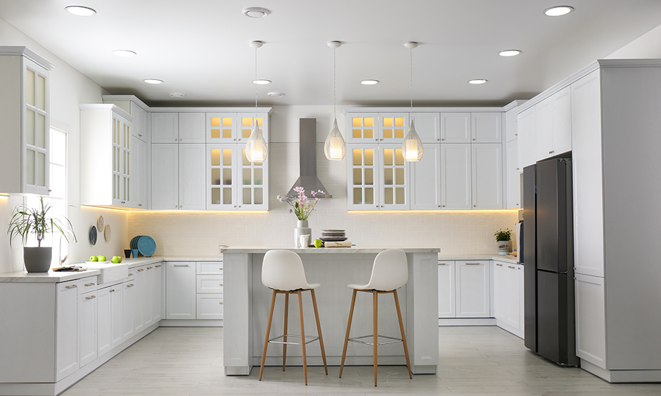 U shaped kitchen layout with a room for island with extra storage space for cupboards and drawers