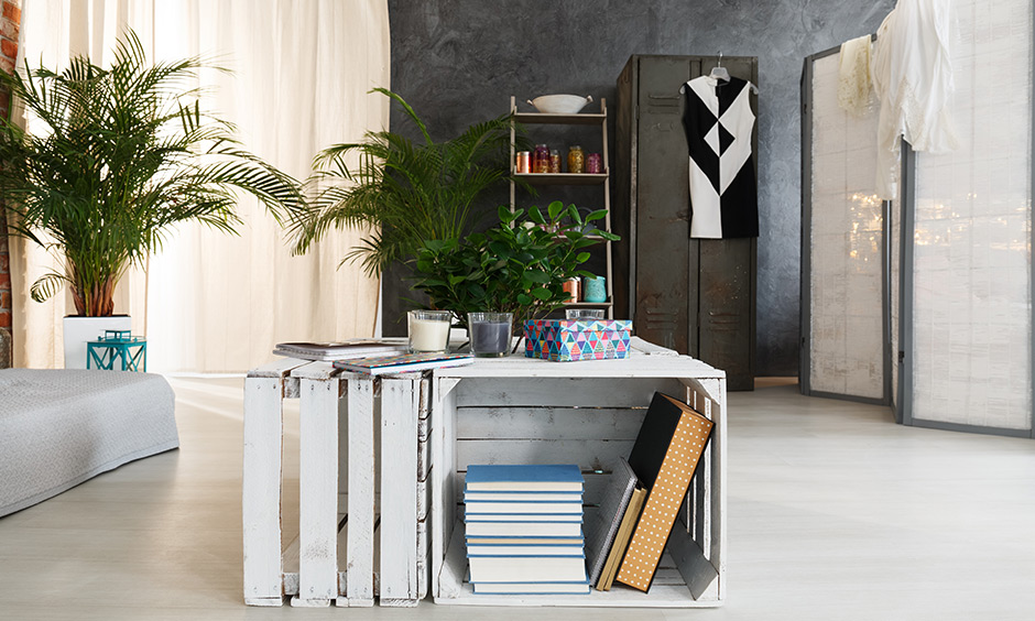 DIY furniture ideas to make a coffee table and ladder rack need four crates, two pipes and small wooden planks.