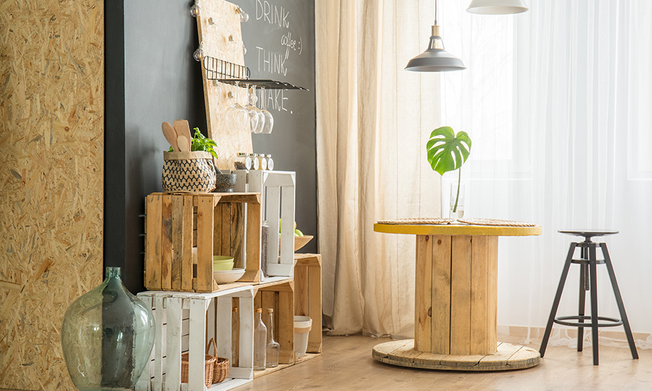 Crates, a cable spool, some wooden discs and plyboard to make DIY furniture brunch corner with a table for two.