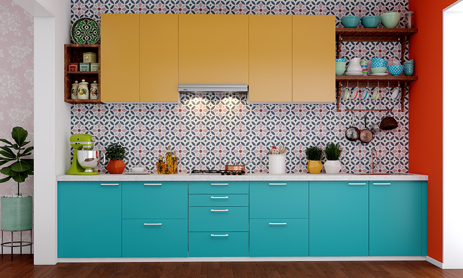 An eclectic low cost kitchen with basic cabinets on top and bottom along drawers  complement the base cabinets with under-sink