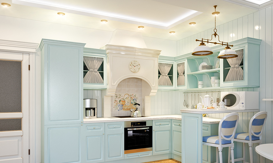 Different types of false ceiling lights in a pretty pastel blue kitchen with led and cove lights