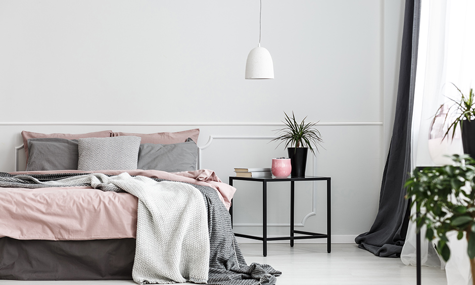 The minimalist black metal bedside table design is a perfect combination of sophistication and affordability for bedroom