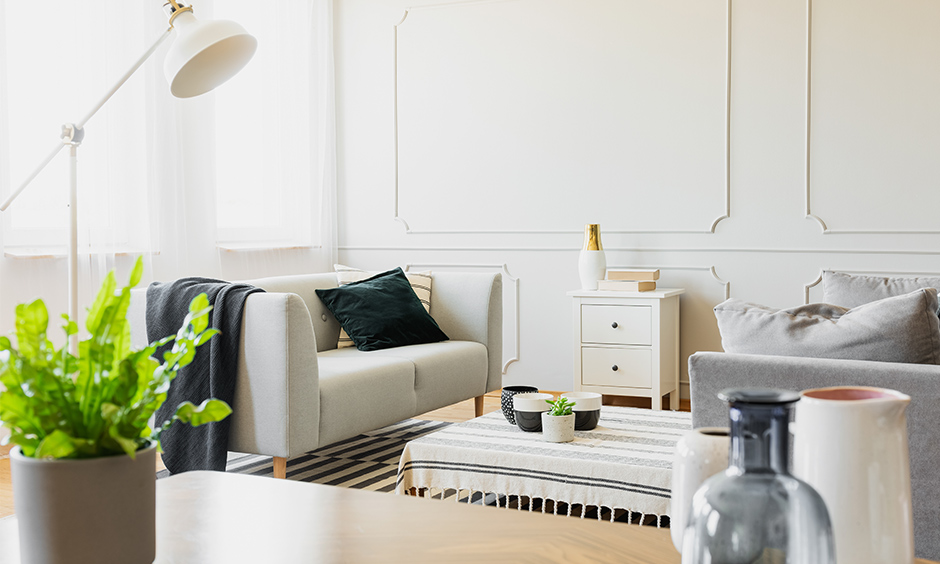 White side table portrays elegance, simplicity and cleanliness and perfect balance between form and function for  living room