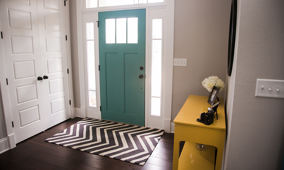 An entryway wall side table has a multitude of purposes can place keys, mail organisers, flower vase and pretty candles.
