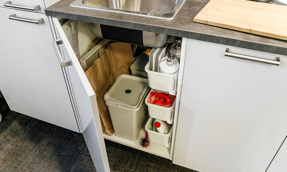 Under sink counter storage in the kitchen keep cleaning supplies, scrubbers, in an easy-to-pull out caddy for clutter-free.