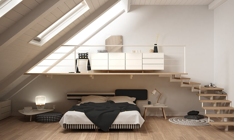 Minimalist bedroom design with a classic wooden stairway suitable in a studio and 1bhk apartment