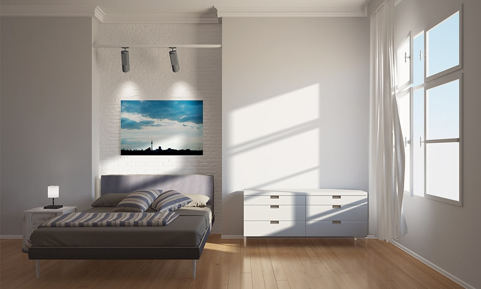 Minimalist bedroom ideas with a murphy bed that can be pushed back to the wall