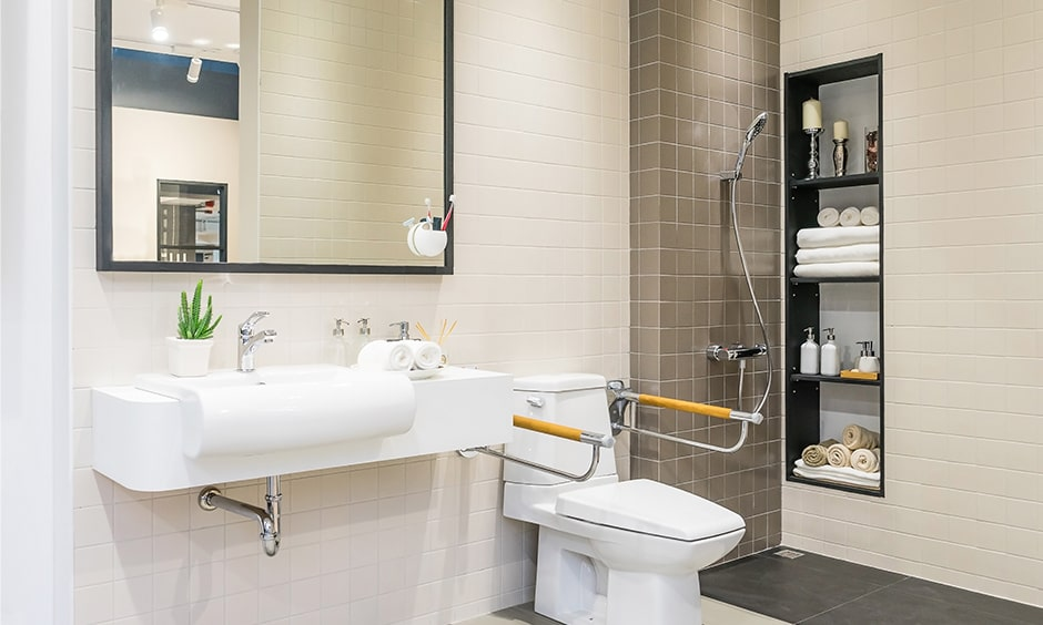 Elderly friendly bathroom designs with a hand shower for old aged persons