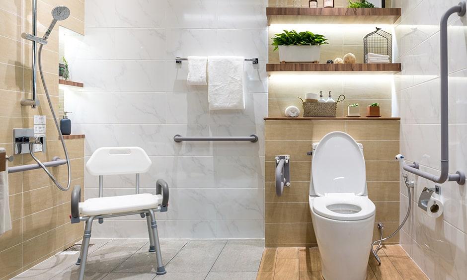 Senior citizen bathroom design with a resting chair below the shower