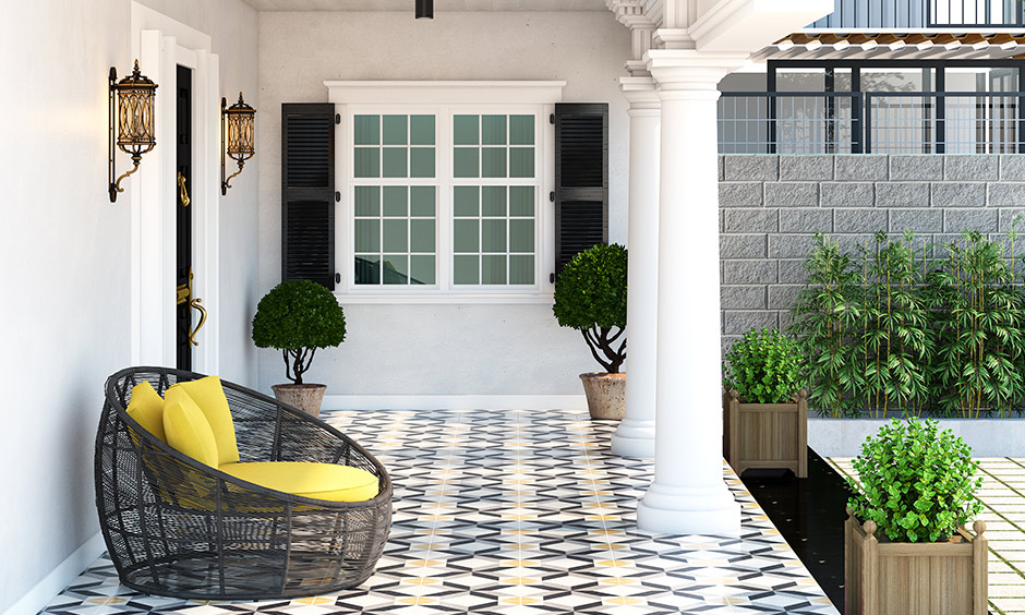 Artistic house porch design with mosaic floor tiles will personalise your home's entrance, and plants add greenery.