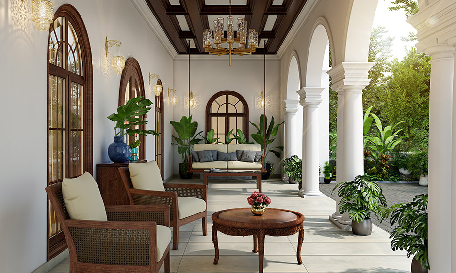 Wooden ceiling, elaborate wrought iron lights and golden accents, binds this home porch design to perfection.
