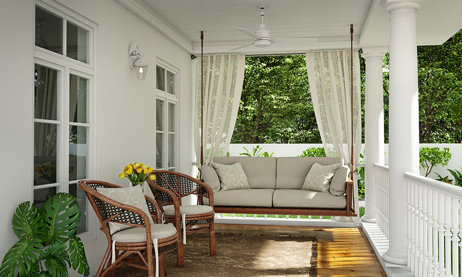 White home front porch design adding a comfortable swing for a refreshing summery look and in winter add throw blankets.