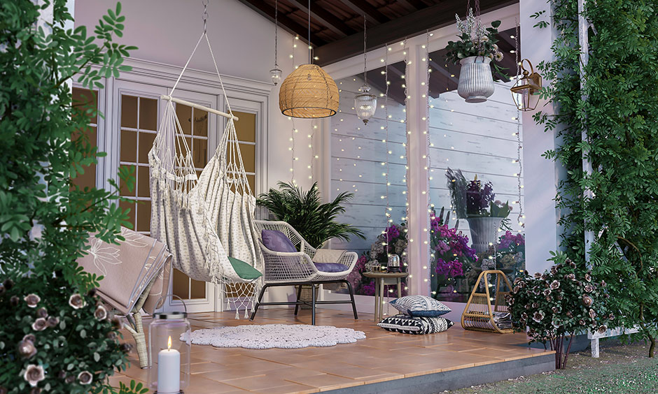 House with porch add white hammock, throw pillows, a wicker chair and fairy lights make it a great spot to entertain