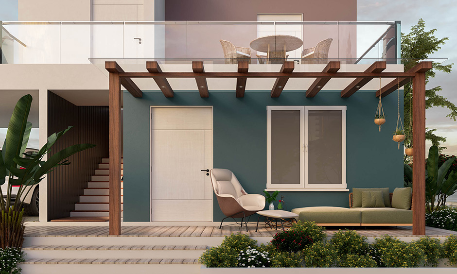 Modern, chic and minimalist house porch design with a pergola, a comfortable couch, and an armchair looks elegant.