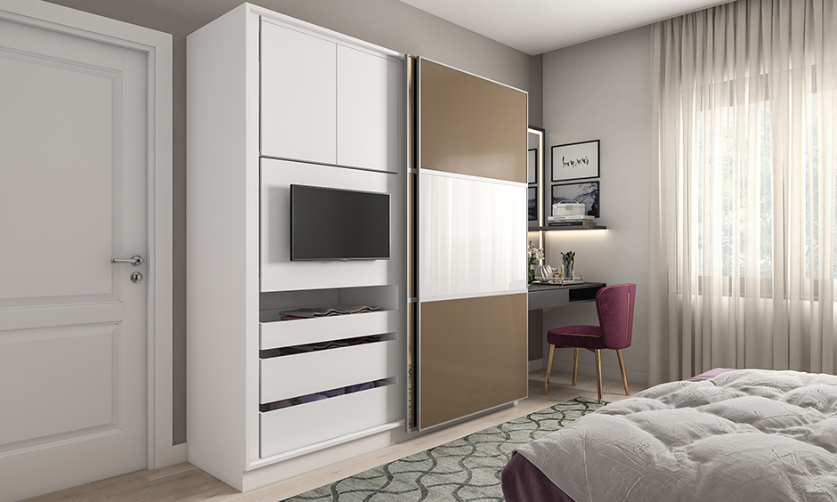 Multifunctional sliding wardrobes with a TV unit is an excellent way to make the most of your guest bedroom space.
