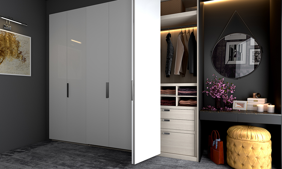 Grey master bedroom wardrobe designs with white lamination feature-rich with a host of accessories and add-ons.