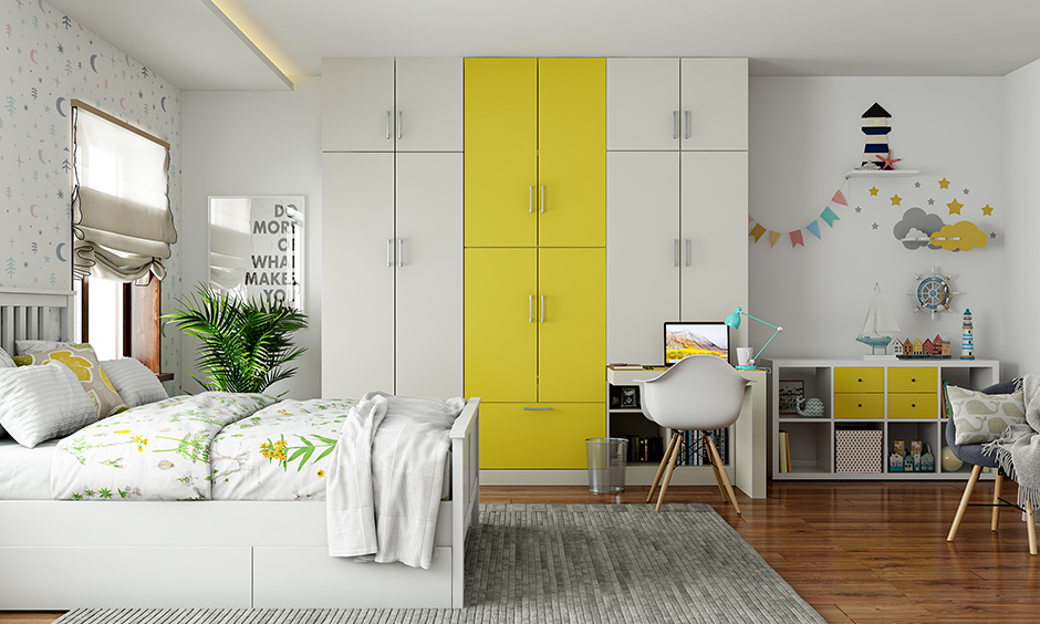 Yellow and white wardrobe for kids bedroom designed to be accessible, low on maintenance and high on storage.