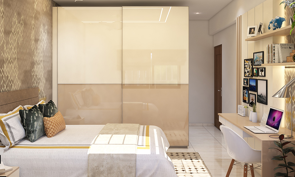 3bhk flat teenage bedroom interior design in Bangalore with a study unit designed in neutral colour looks gorgeous