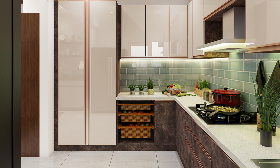 This L shaped modular kitchen in Bangalore with a pop of colour the dado wall has highlighted with marine green tiles.