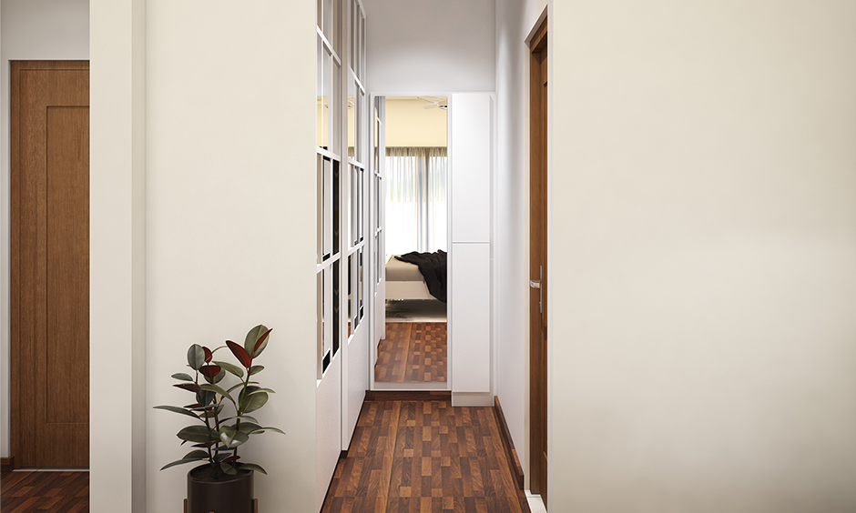 Master bedroom interior design in Bangalore with a walk-in closet with a full-length wardrobe and mirror