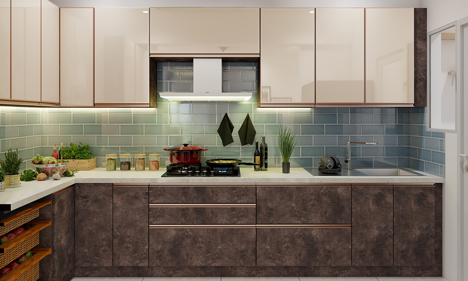 This open modular kitchen in Bangalore brings about a classy look with lacquered glass on cabinet shutters