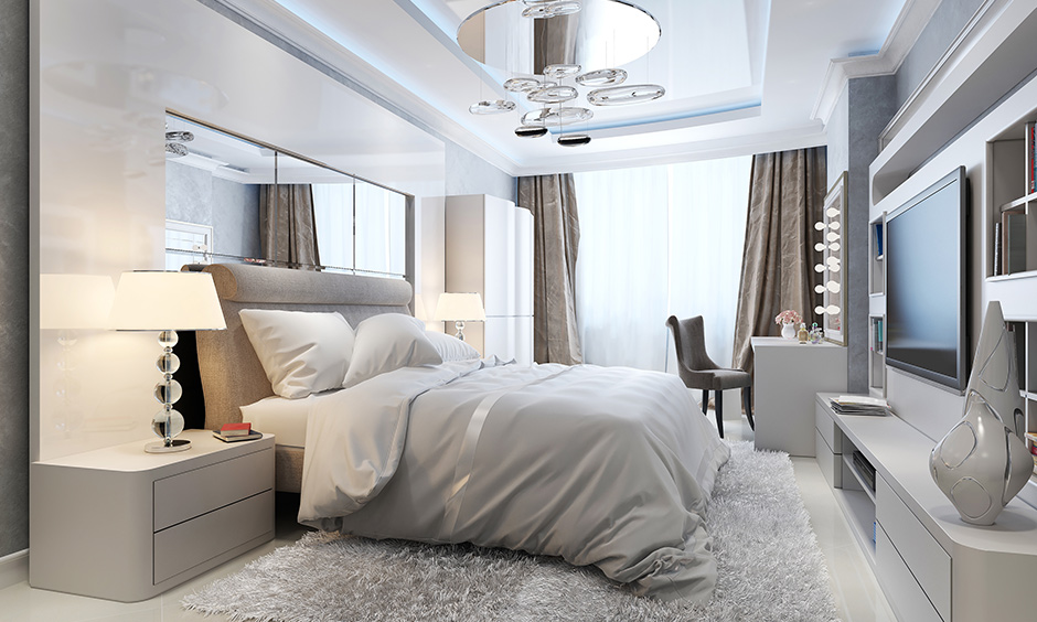 Opulence modern bedroom false ceiling, choose glass panels or crystals to make your modern false ceiling more inviting.